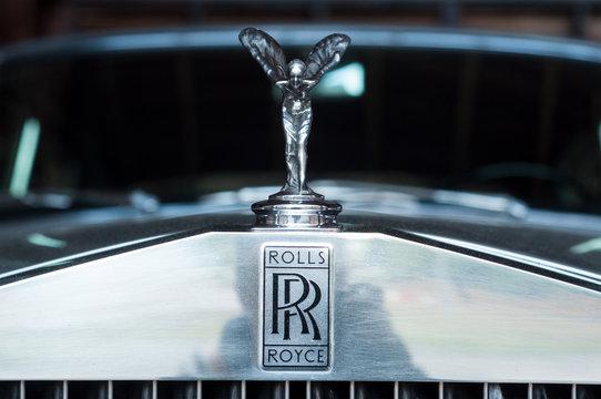 closeup of Rolls Royce logo on car