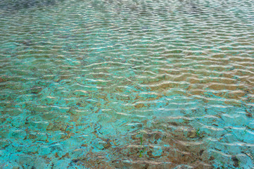 Close up of water surface in outdoor pool with transparent water