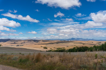 Vast South African countryside landscape with dry grass and hills
