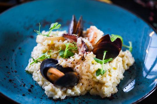 risotto with fresh seafood & shrimps, shells, octopus, calamari