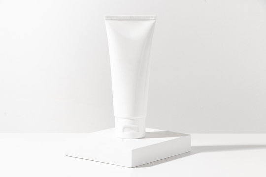 cosmetic lotion cream mockup bottle pakage with white wood plate, beauty spa treatment concept
