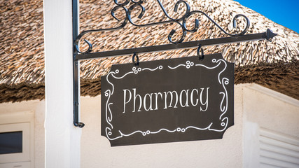 Street Sign to Pharmacy