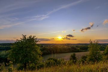 Tuinposter Ochtendgloren A beautiful sunset with a golden sunshine on a late summer evening. Concept: landscape or travel