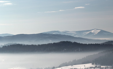winter landscape with mountains and fog - 284494775