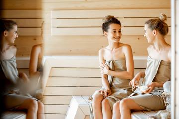 Girlfriends in the sauna
