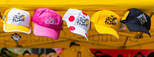 Col du Glandon, France - July 23, 2015: Image of promotional caps of Le Tour de France hanging at an Official Shop located on Col du Glandon in Alps during Le Tour de France 2015.