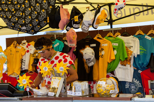 Rouen,France,July 5th, 2012: A young man selling various promotional items on the official Tour of France shop in Rouen Le Tour de France.