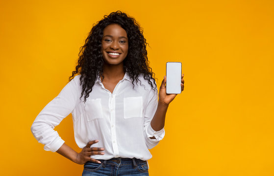Cheerful black woman showing latest slim cellphone