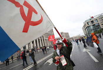 A man waves a flag during a rally organised by the Russian Communist party, demanding fair elections to Moscow City Duma, the capital's regional parliament, in Moscow