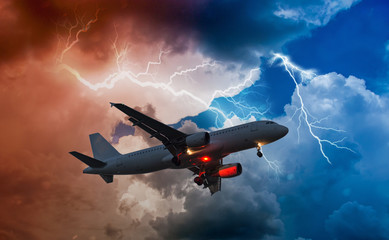 an airplane flies in bad weather and storm with lightning bolt
