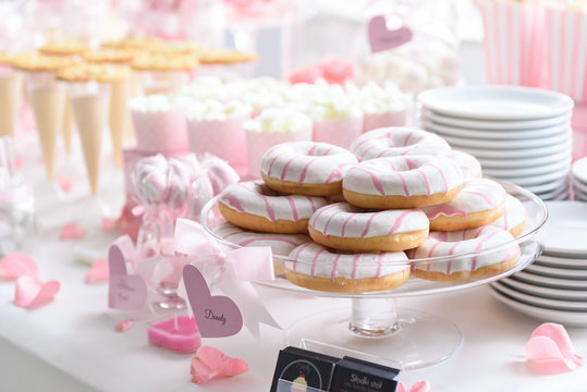 Tasty donuts and other sweets on a wedding candy bar