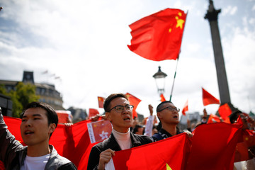 Demonstrators in support of the Chinese government gesture towards demonstrators supporting the Hong Kong protestors, in central London
