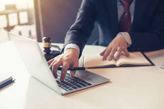 Lawyer using laptop for litigation information in law firms.