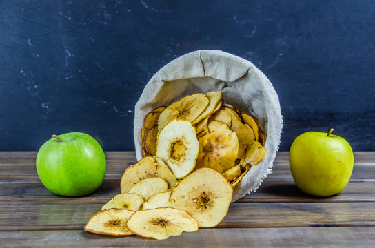 vegetarian apple chips on a brown background
