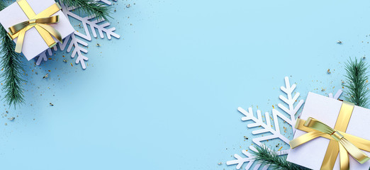 Blue Christmas background decorated with two white gifts and snowflakes 3D Rendering