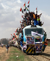Sudanese civilians from other provinces ride on the train to join in the celebrations of the signing of the Sudan's power sharing deal, that paves the way for a transitional government, and eventually elections, following the overthrow of long-time leader