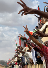 Sudanese civilians flash victory signs as they ride on the train to join in the celebrations of the signing of the Sudan's power sharing deal, that paves the way for a transitional government, and eventually elections, following the overthrow of long-time