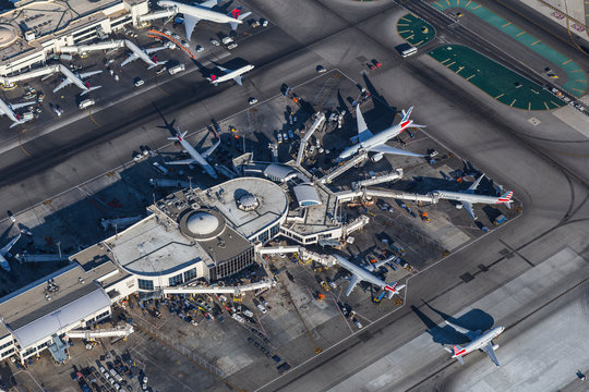 Afternoon aerial view of jet airplanes surrounding terminal at LAX on August 16, 2016 in Los Angeles, California, USA.