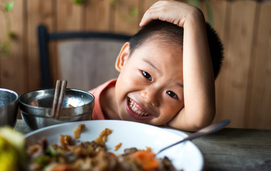 Asian child having lunch at the restaurant