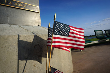 American flag and shadow at veterans memorial