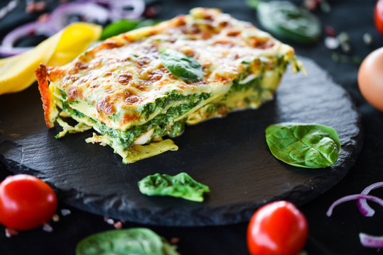 italian lasagna slice with fresh ingredients