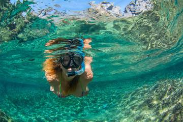 Fototapeta Woman snorkeling in the sea at Tenerife Canary Islands Spain obraz