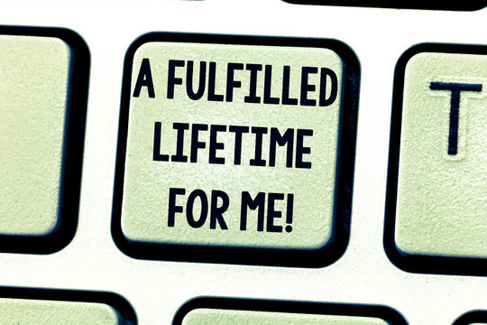 Text sign showing A Fulfilled Lifetime For Me. Conceptual photo Realization achievements Accomplish goals Keyboard key Intention to create computer message pressing keypad idea