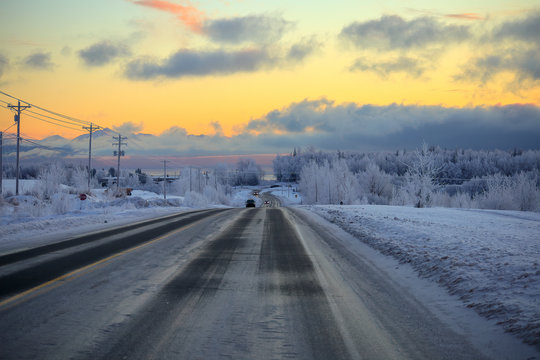 Road in Anchorage Alaska in winter during a spectacular winter sunset