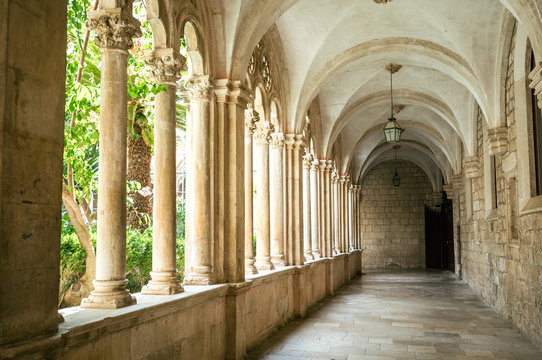 Courtyard with columns and arches in old Dominican monastery in Dubrovnik, Croatia
