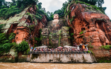 Wide angle view of Leshan Giant Buddha or Dafo from river boat in Leshan China