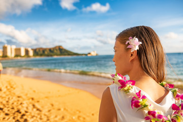Wall Mural - Hawaii woman wearing lei flower necklace and hair accessory on beach sunset for luau party or honeymoon wedding in Waikiki beach, Honolulu, holiday travel.