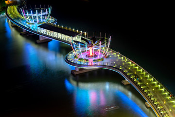 Colorful night walking bridge in Can Tho, Vietnam. This is Ninh Kieu wharf area along the waterway center in the Mekong Delta from the early 19th century