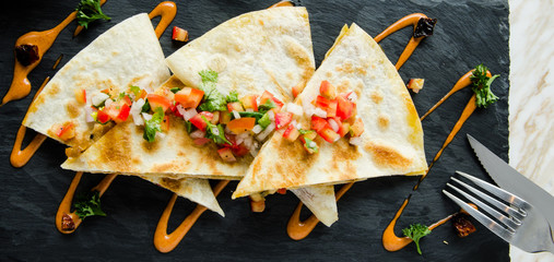 Quesadillas with salsa mexican Sauce serve with Cheese