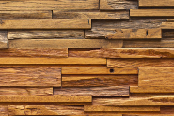 Texture of a wall of wooden bars. Stone bricks are made in the form of wooden boards.