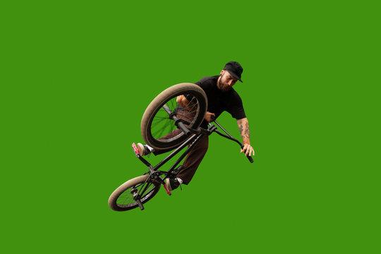BMX rider on green screen.