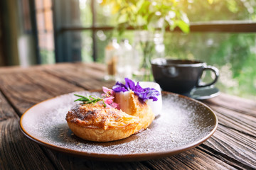 A piece of coconut pie with a beautiful decoration in a plate Fototapete