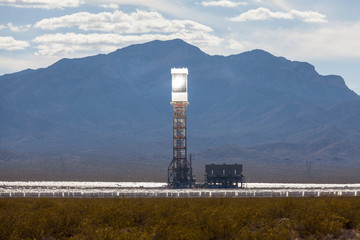 Editorial view of the glowing Ivanpah solar thermal power plant tower in California's Mojave desert on May 12, 2013 in Ivanpah, California, USA.