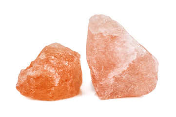 crystals of pink Himalayan salt on white