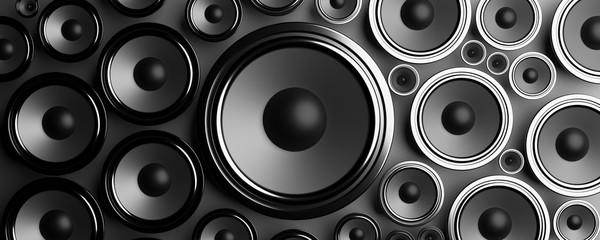 Multiple various size black Loudspeakers background. 3d illustration