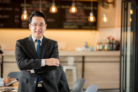 Portrait of happy asian  businessman.