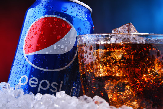 A can and a glass of Pepsi