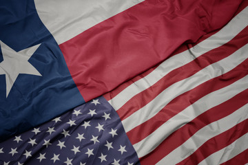 waving colorful flag of united states of america and flag of texas state.