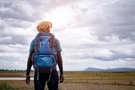 African tourist  traveler man with backpack on view of mountain background