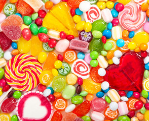 Fototapete - Colorful lollipops and different colored round candy.
