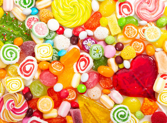 Wall Mural - Colorful lollipops and different colored round candy.