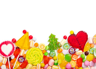 Wall Mural - Colorful lollipops and different colorful candy isolated on white