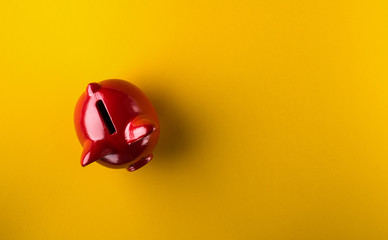 Red piggy bank on yellow background Wall mural