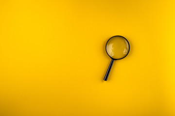 magnifying glass on yellow background Wall mural