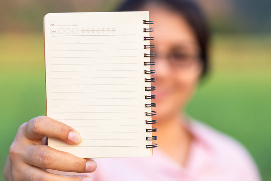 Woman Show Empty Notebook
