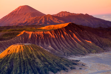 The beautiful sunrise at Mount Bromo volcano, the magnificent view of Mt. Bromo located in Bromo Tengger Semeru National Park, East Java, Indonesia.Image contains noise grain and blurry. Fototapete